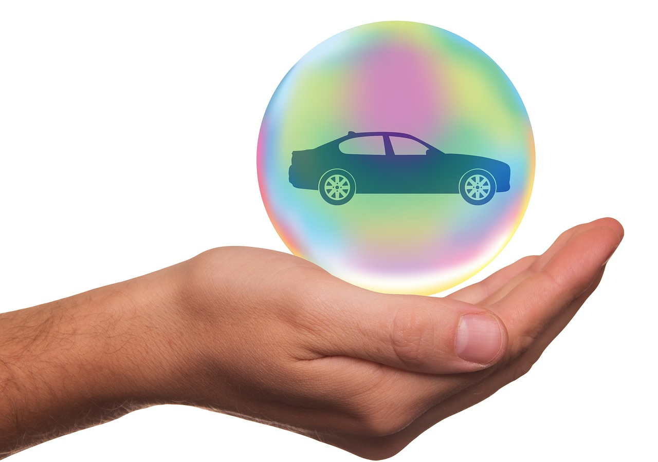 insurance car in your hand
